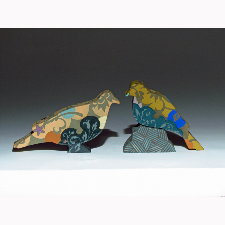 Three piece porcelain bird sculpture featuring doves