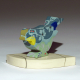 """'Feathers Up"""" porcelain songbird sculpture on base"""